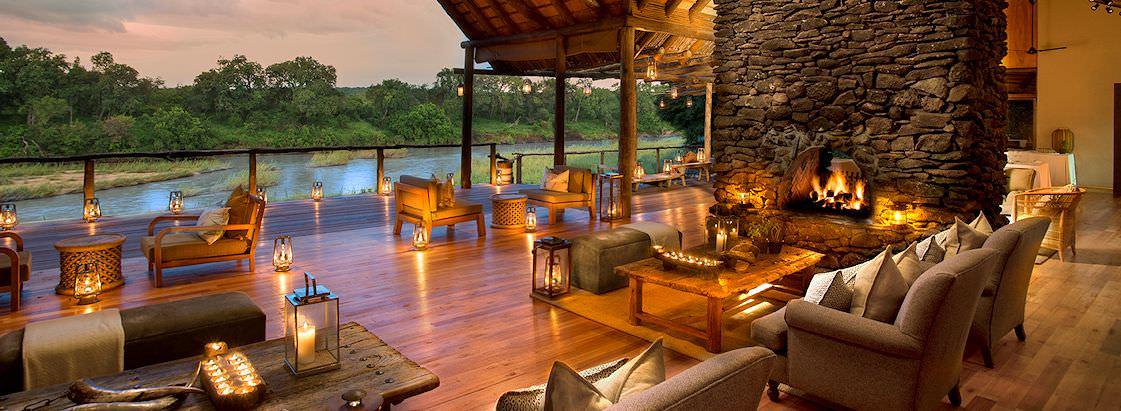 The stunning deck area at Lion Sands Narina Lodge overlooking the Sabie River.