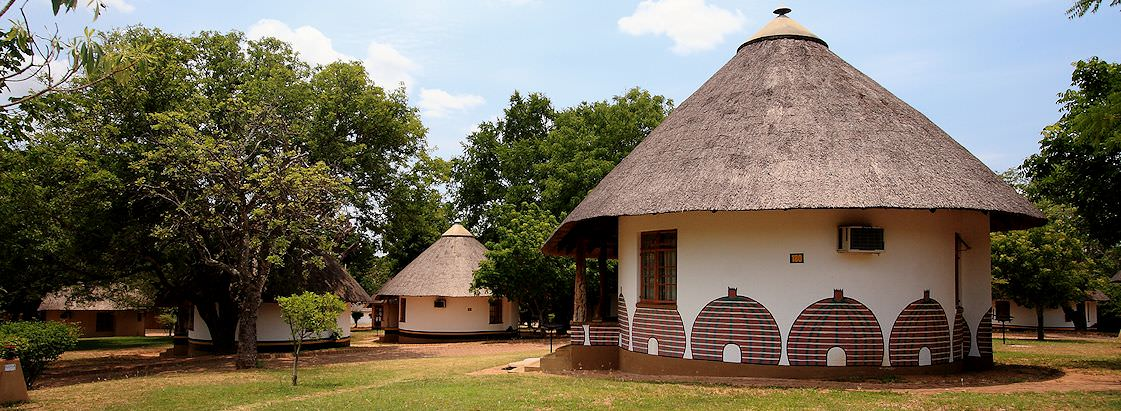 Rondavel-style chalets in a Kruger National Park rest camp.