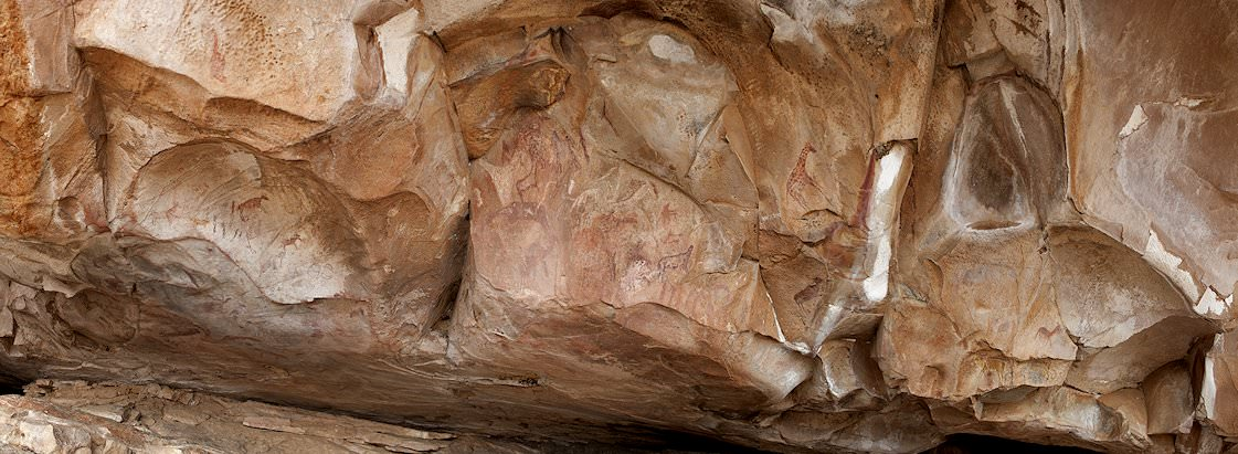 Faded San rock art at Game Pass Shelter in the Drakensberg.