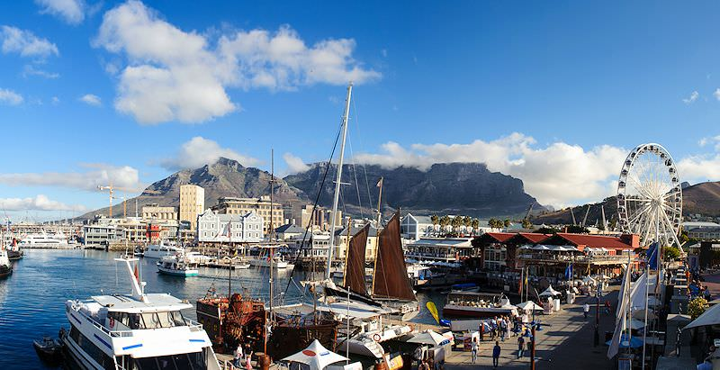 Table Mountain looms above the Victoria & Alfred Waterfront in Cape Town.