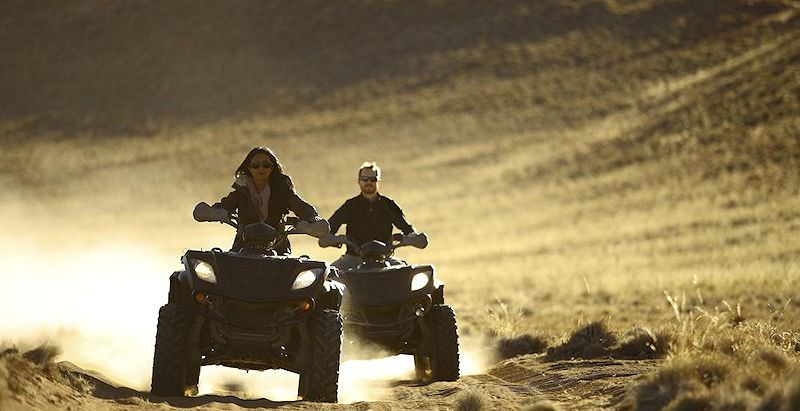A couple blast across the Namib Desert on their quad bikes.