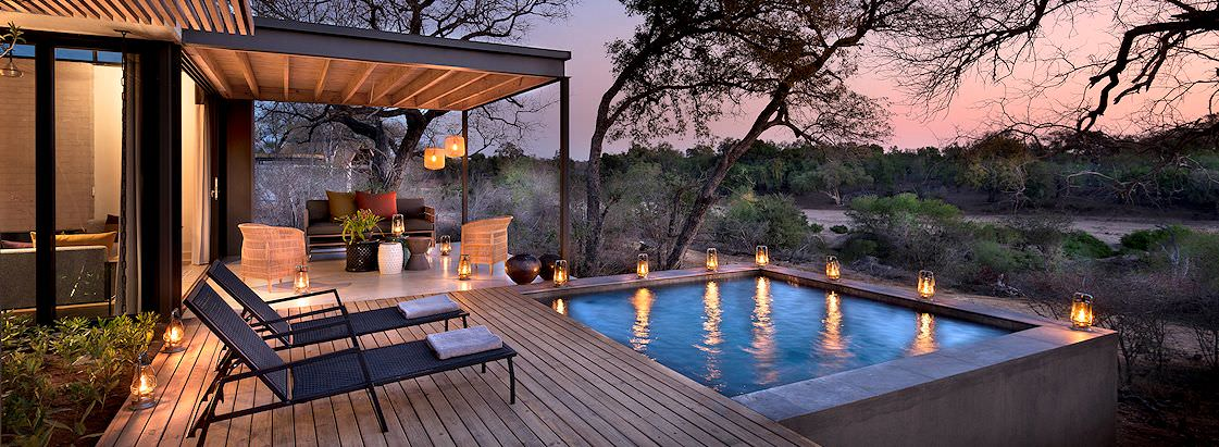 The exterior of a plush private villa at Lion Sands Ivory Lodge in the Sabi Sand Private Game Reserve.