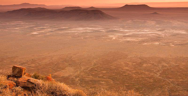 The sun sets over the vast, arid expanse of the Karoo.