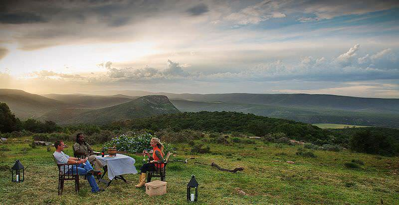 Guests relax in a scenic spot during the afternoon game drive in Shamwari.