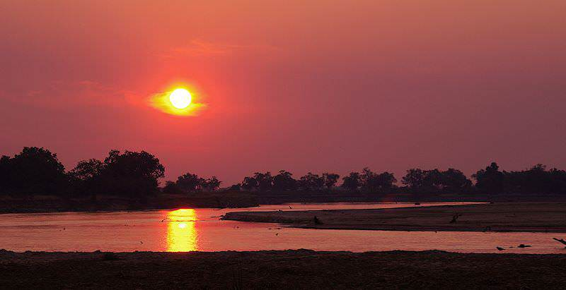 The sun sets over the Luangwa River in South Luangwa National Park.