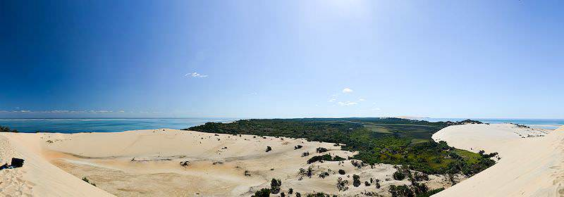 Immense dunes and verdant vegetation on an island in Mozambique.