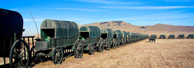Historic oxwagons on a battlefield in KwaZulu-Natal.