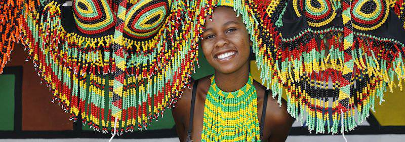 A young girl proudly displays traditional beadwork.