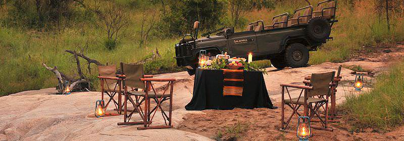 A bush dinner set up in the wilderness of the Sabi Sand Private Game Reserve.