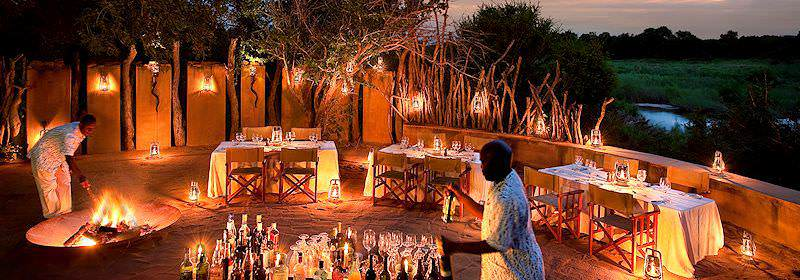 The boma area at a Lion Sands lodge lit up at night.
