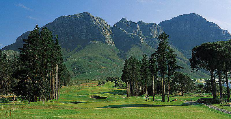 The imposing mountains of the Cape Fold stand guard above Erinvale Golf Course.