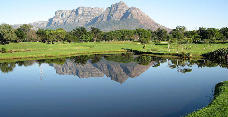 Devil's Peak and the backslopes of Table Mountain reflected in a water hazard at Mowbray Golf Course.