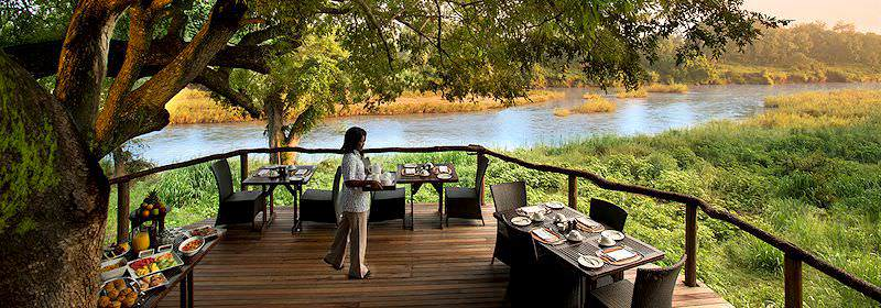 Breakfast is served on the deck of Lion Sands Narina Lodge.