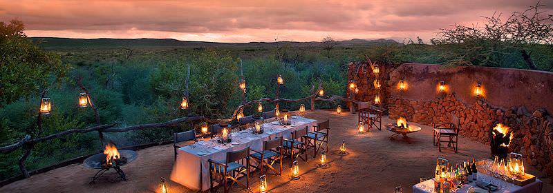 A lantern-lit boma dinner at Madikwe Safari Lodge.