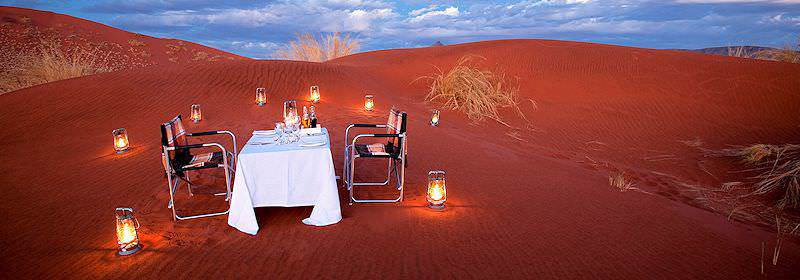 Relish a private dining experience atop a sand dune in Namibia's Sossusvlei.
