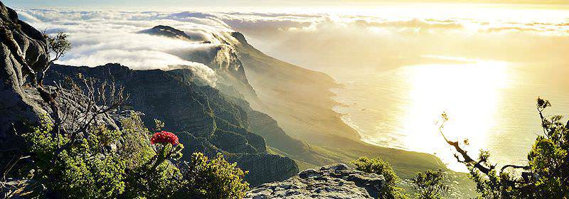 The sun sets over the mountainous Cape peninsula.