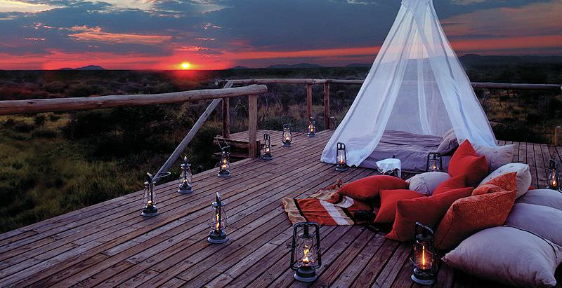 A romantic outdoor sleepout at Sanctuary Makanyane Madikwe during the 8 Day East West Luxury Safari Honeymoon