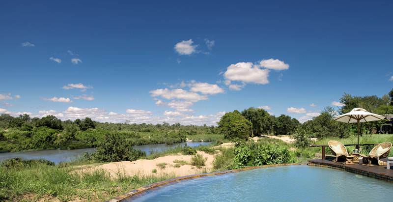 Relax in the swimming pool at Lion Sands River Lodge during your 3 Day Quick Private Lodge Safari.
