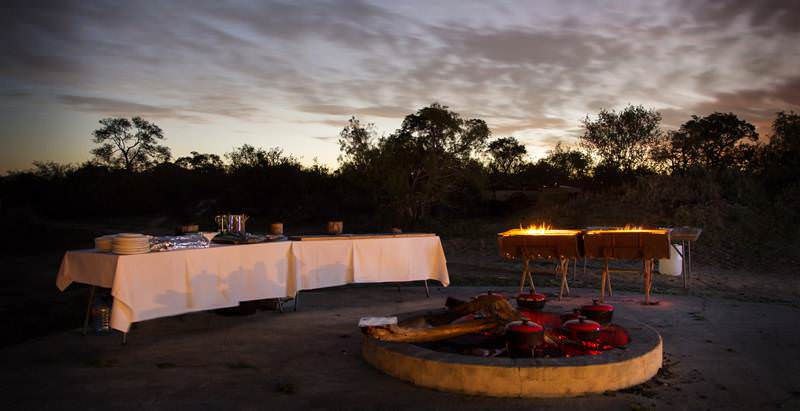 A boma evening at Arathusa Safari Lodge during a 5 Day Kruger Park and Private Lodge Safari.