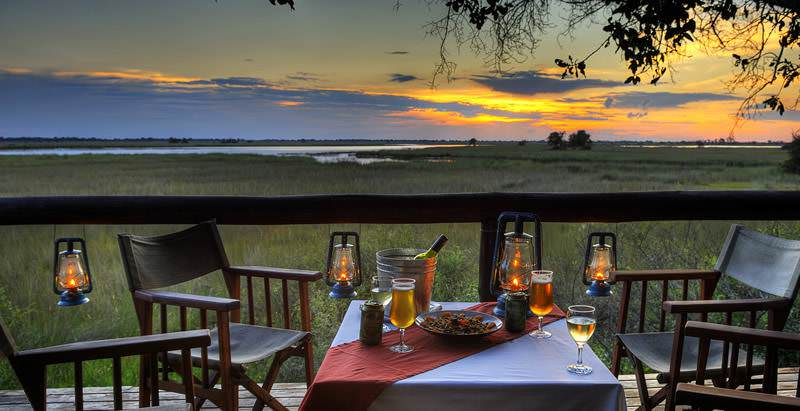 Sunset refreshments in the Okavango Delta during the 21 Day Spirit of Southern Africa safari.