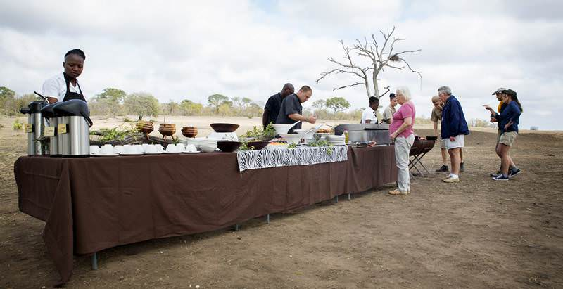 A lavish bush breakfast enjoyed during a 7 Day Kruger and Victoria Falls Safari.