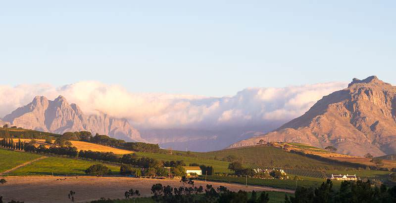 Dramatic scenery abounds during the 1 Day Franschhoek Wine Route Tour.