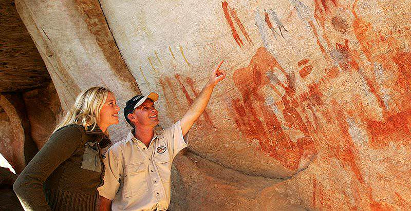 A guest enjoys a guided experience at Bushmans Kloof on the 10 Day South African Rock Art Tour.