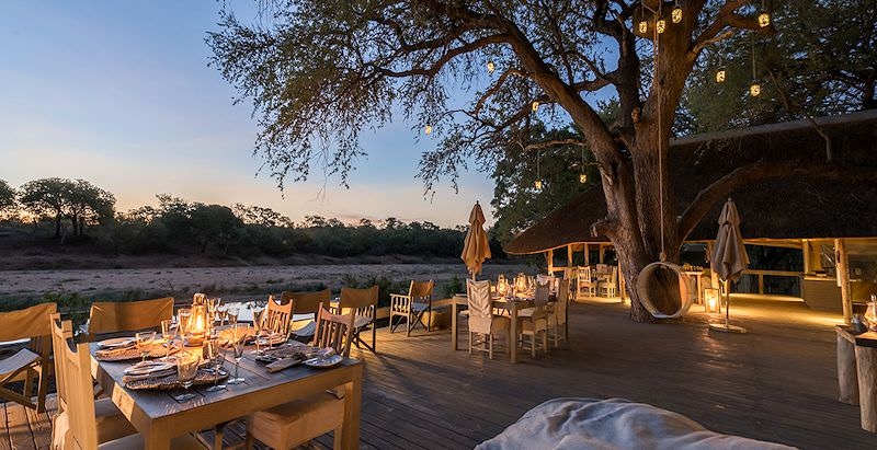 The dining deck at Simbavati River Lodge, which is included in the 6 Day Kruger Wildlife Family Safari.