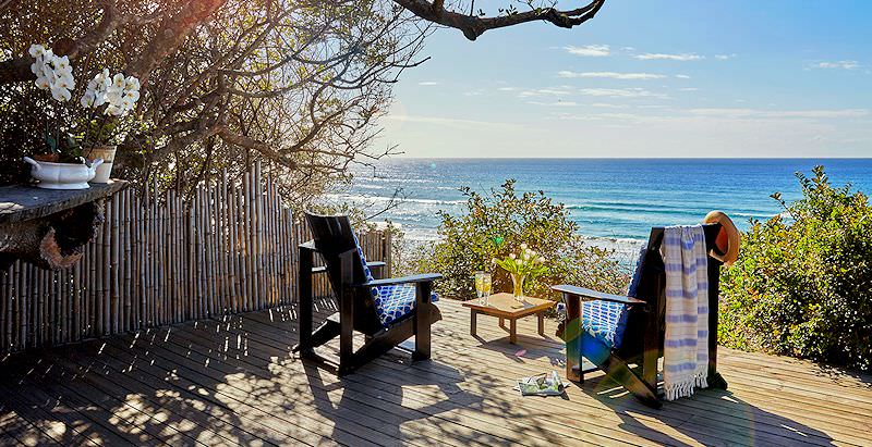 A private deck with a view at Prana Lodge, the accommodation of choice on the 7 Day East Cape Wild Coast Package.