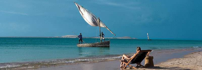 A traveler observes fishermen on a dhow in Mozambique.