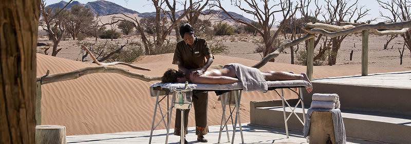 A guest enjoys a pampering spa treatment surrounded by the dunes of Sossusvlei.