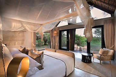 The interior of a sumptuous suite at Lion Sands River Lodge.