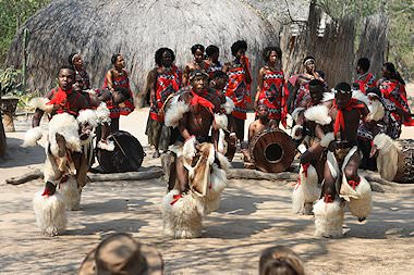 A traditional performance at a cultural village in Southern Africa.