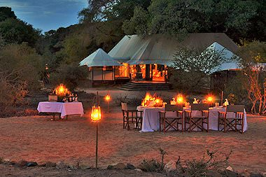 An al fresco dinner prepared at Hamiltons Tented Camp in the Kruger National Park.