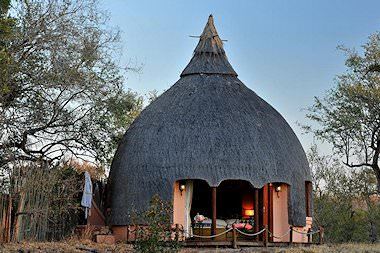 The exterior of a traditionally thatched chalet at Hoyo Hoyo Safari Lodge.