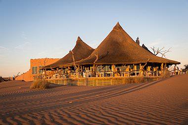 Little Kulala Lodge emerges from the sands of the Namib Desert 		  .