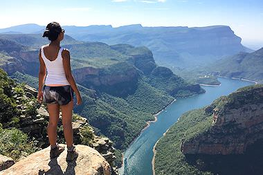 A traveler relishes the view of the Blyde River Canyon.