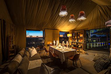 A dining room in a plush tented lodge in Zambia.