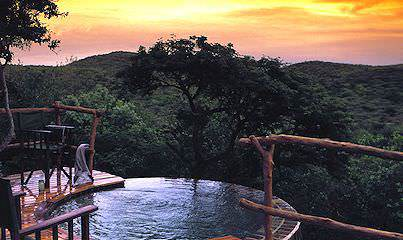 Unwind in the privacy of your suite's plunge pool during a honeymoon at Phinda Rock Lodge.