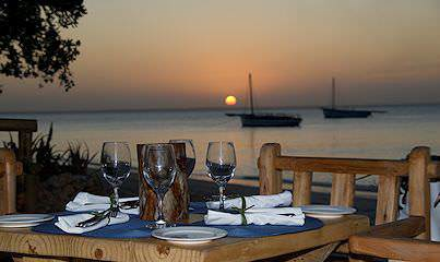 A beach dinner with a view of the sunset at Azura Benguerra Lodge in Mozambique.